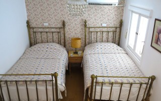 Large antique beds dressed up with fine Egyptian cotton